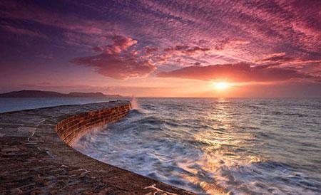 عکس های تماشایی غروب آفتاب در نقاط دیدنی جهان