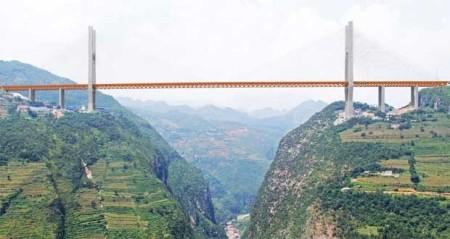 بلندترین پل جهان روی جنگل در چین ساخته شد + تصاویر
