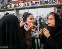 نقاشی پرچم ایران روی صورت دختران تهرانی در 22 بهمن