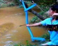شکار ماهی با تیرکمان توسط یک دختر زیبا (عکس)
